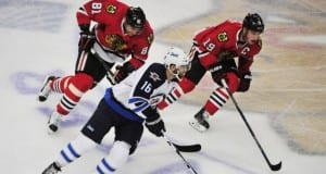 Andrew Ladd and Marian Hoss and Jonathan Toews of the Chicago Blackhawks