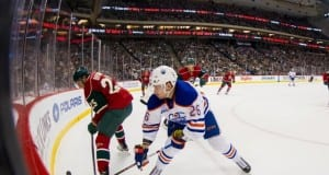 Jonas Brodin of the Minnesota Wild and Iiro Pakarinen of the Edmonton Oilers