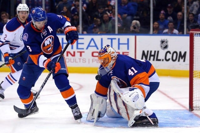 Travis Hamonic and Jaroslav Halak