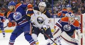 Matt Moulson of the Buffalo taking on the Edmonton Oilers