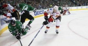 Tyler Seguin of the Dallas Stars and Matt Stajan of the Calgary Flames