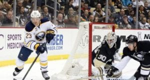 Matt Murray of the Pittsburgh Penguins and Sam Reinhart of the Buffalo Sabres