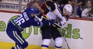 Kevin Shattenkirk of the St. Louis Blues and Jannik Hansen of the Vancouver Canucks