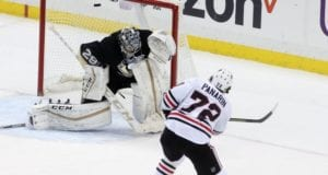 Chicago Blackhawks Artemi Panarin scoring on Pittsburgh Penguins goalie Marc-Andre Fleury