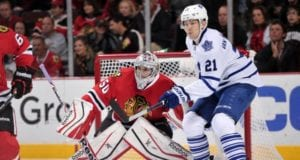 James van Riemsdyk of the Toronto Maple Leafs and Corey Crawford of the Chicago Blackhawks
