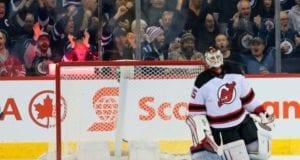 New Jersey Devils goalie Cory Schneider watches replay of Winnipeg Jets winger Patrik Laine's goal