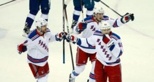 Kevin Klein, J.T. Miller and Rick Nash of the New York Rangers