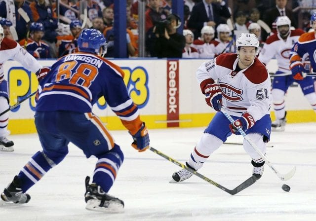 The Edmonton Oilers have traded defenseman Brandon Davidson to the Montreal Canadiens for center David Desharnais.