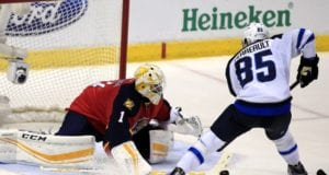 Mathieu Perreault lof the Winnipeg Jets and Roberto Luongo of the Florida Panthers