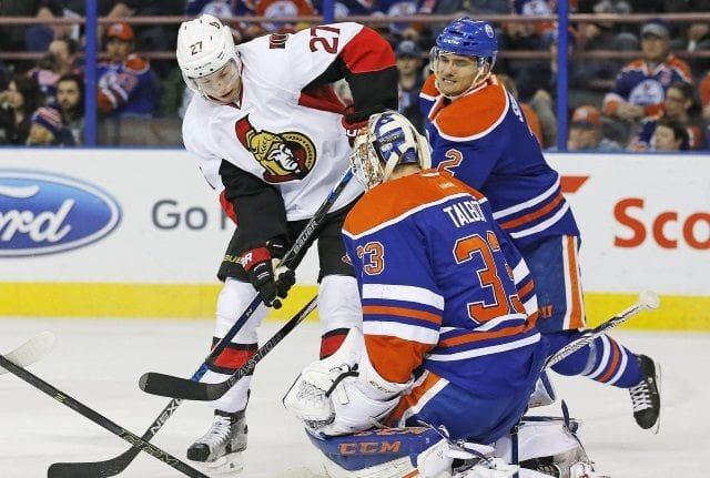 Curtis Lazar of the Ottawa Senators and Cam Talbot of the Edmonton Oilers