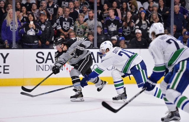 Tyler Toffoli of the LA Kings and Ben Hutton of the Vancouver Canucks