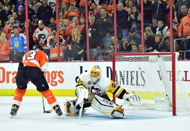 Marc-Andre Fleury of the Pittsburgh Penguins and Jakob Voracek of the Philadelphia Flyers