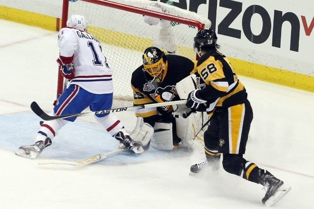 Marc-Andre Fleury of the Pittsburgh Penguins and Brendan Gallagher of the Montreal Canadiens