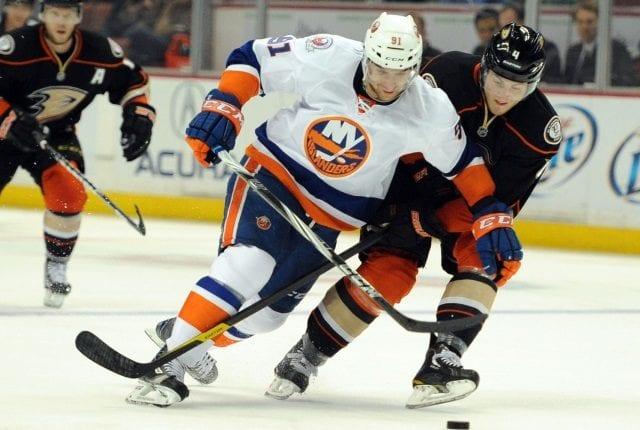 John Tavares of the New York Islanders and Cam Fowler of the Anaheim Ducks