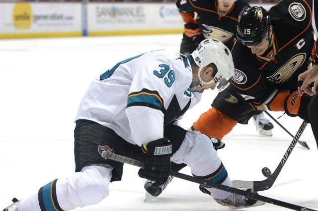 Logan Couture of the San Jose Sharks and Ryan Getzlaf of the Anaheim Ducks