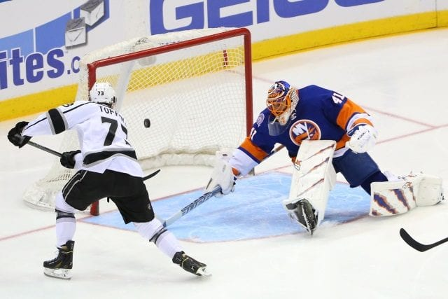 Tyler Toffoli of the Los Angeles Kings and Jaroslav Halak of the New York Islanders