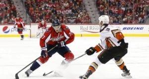 T.J. Oshie of the Washington Capitals and Clayton Stoner of the Anaheim Ducks