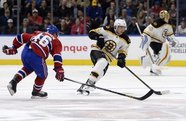 Ryan Spooner of the Boston Bruins and Artturi Lehkonen of the Montreal Canadiens