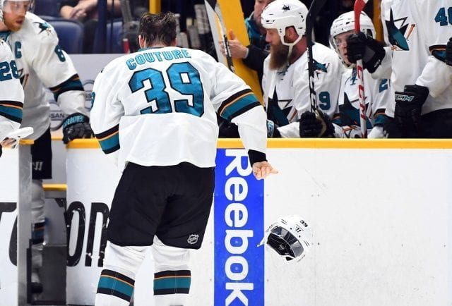 San Jose Sharks forward Logan Couture takes a puck to the mouth