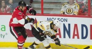 Marc Methot of the Ottawa Senators and Brad Marchand of the Boston Bruins