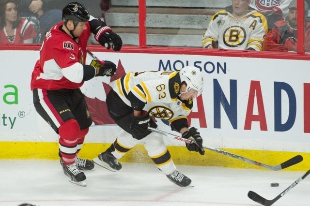 Marc Methot of the Ottawa Senators and Brad Marchand of the Boston Bruins