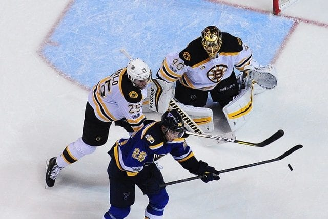 Paul Stastny of the St. Louis Blues and Brandon Carlo of the Boston Bruins