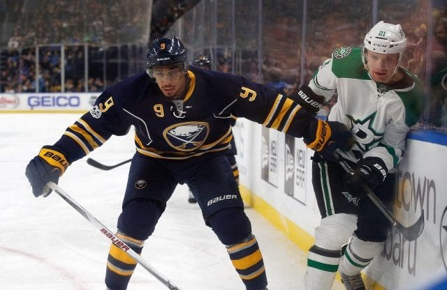 Evander Kane of the Buffalo Sabres and Antoine Roussel of the Dallas Stars