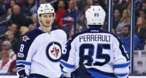 Jacob Trouba and Mathieu Perreault of the Winnipeg Jets