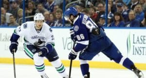 Alex Edler of the Vancouver Canucks and Nikita Kucherov of the Tampa Bay Lightning