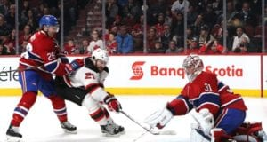 Carey Price of the Montreal Canadiens and Kyle Palmieri of the New Jersey Devils