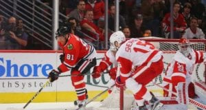 Petr Mrazek of the Detroit Red Wings and Marian Hossa of the Chicago Blackhawks