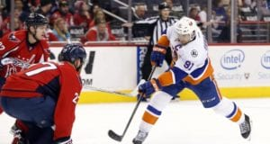 John Tavares of the New York Islanders and Karl Alzner of the Washington Capitals