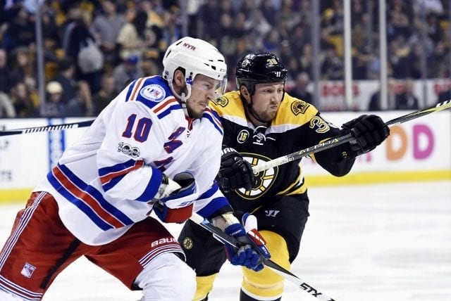 J.T. Miller of the New York Rangers and Matt Beleskey of the Boston Bruins