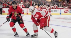 Andreas Athanasiou of the Detroit Red Wings and Mike Hoffman of the Ottawa Senators