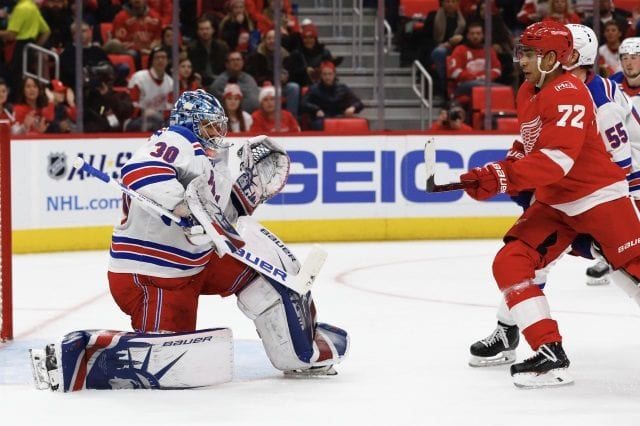 Andreas Athanasiou of the Detroit Red Wings and Henrik Lundqvist of the New York Rangers.