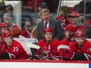 The Calgary Flames have been talking to Carolina Hurricanes coach Bill Peters