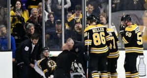 Boston Bruins defenseman Brandon Carlo stretchered off with a leg injury.
