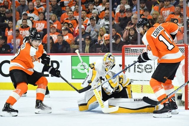 Flyers Sean Couturier leaves practice early after a collision with Radko Gudas.