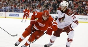 Oliver Ekman-Larsson of the Arizona Coyotes and Gustav Nyquist of the Detroit Red Wings.
