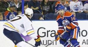 Zach Bogosian of the Buffalo Sabres and Jordan Eberle of the Edmonton Oilers