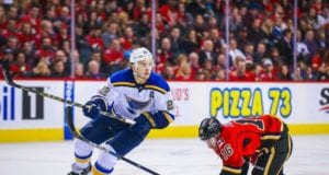 Kevin Shattenkirk of the St. Louis Blues and Josh Jooris of the Calgary Flames