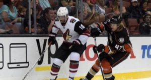 Hampus Lindholm of the Anaheim Ducks and Anthony Duclair of the Arizona Coyotes
