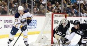 Matt Murray of the Pittsburgh Penguins and Sam Reinhart of the Buffalo Sabres