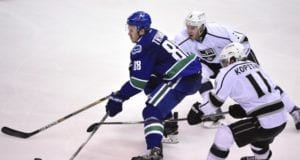 Nikita Tryamkin of the Vancouver Canucks and Brayden McNabb of the Los Angeles Kings