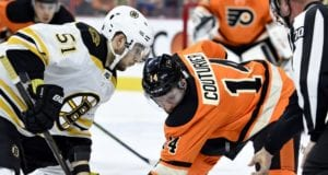 Ryan Spooner of the Boston Bruins and Sean Couturier of the Philadelphia Flyers