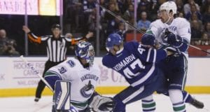 Erik Gudbranson and Ryan Miller of the Vancouver Canucks