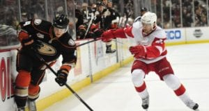 Cam Fowler of the Anaheim Ducks and Tomas Tatar of the Detroit Red Wings