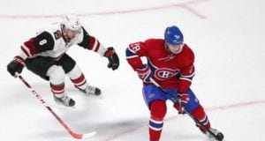 Nathan Beaulieu of the Montreal Canadiens and Tobias Rieder of the Arizona Coyotes