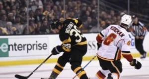 Dennis Wideman of the Calgary Flames and Matt Beleskey of the Boston Bruins