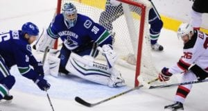 Ryan Miller of the Vancouver Canucks and Patrik Elias of the New Jersey Devils